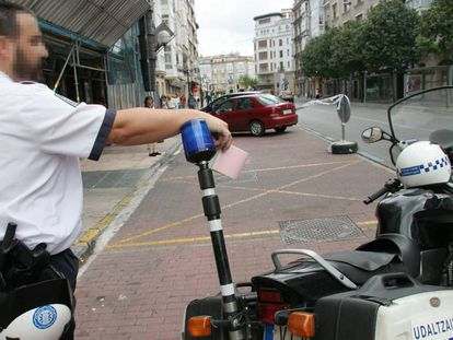 A police officer issuing a parking ticket in Vitoria.