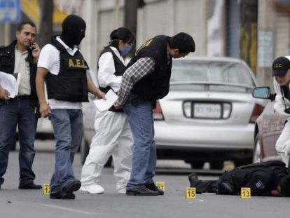 Police in Monterrey try to reconstruct a recent crime scene.