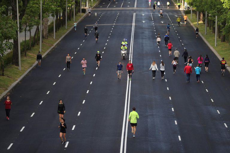 Residents of Madrid take exercise on Sunday along the city's Paseo de la Castellana thoroughfare.