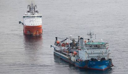 Ships lay out the Western Link submarine cable.