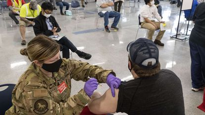 A man receives the Janssen Covid-19 vaccine on the grounds of a Toyota plant in Buffalo, West Virginia.