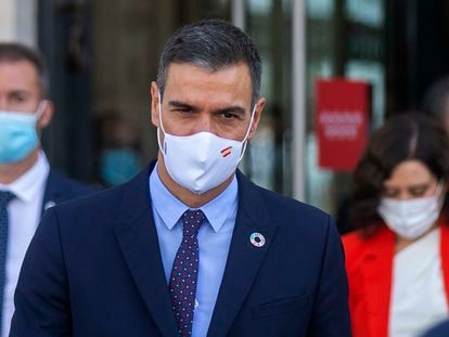 Spanish Prime Minister Pedro Sánchez  walking out of a meeting at Madrid regional headquarters.