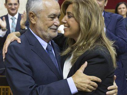 José Antonio Griñán embraces his successor as Andalusia premier, Susana Díaz.