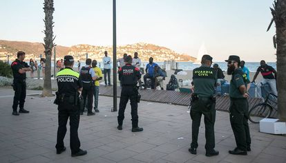 Local police officers and Civil Guards in the Catalan resort town of Roses.