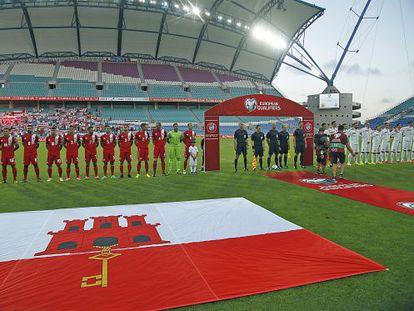 The Gibraltar team (left) in the Estádio Algarve in Faro on Sunday.