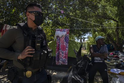 A police officer from Coahuila inside the Haitian migrant camp in Ciudad Acuña on Thursday.
