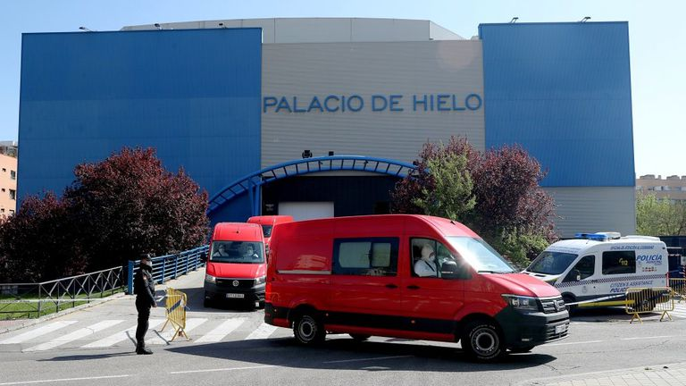 The bodies of coronavirus victims are brought to Madrid's Palacio de Hielo, an ice rink that has been converted into a temporary morgue.