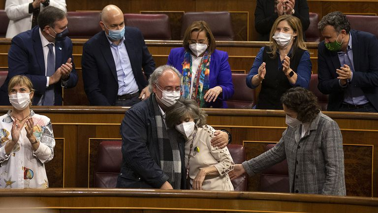 Socialist lawmaker Maria Luisa Carcedo, who pushed for an euthanasia law when she was health minister, is embraced by fellow deputies after the vote.