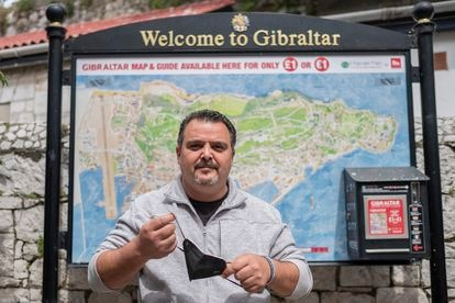 Juan Jesús Arenas, a Spaniard who works in Gibraltar, removes his mask in the British Overseas Territory.