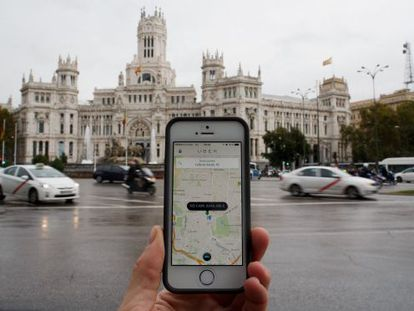 A smartphone running the Uber app in central Madrid.