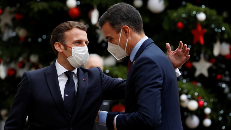 French President Emmanuel Macron welcomes Spanish Prime Minister Pedro Sanchez at the Elysee Palace as part of events marking the 60th anniversary of the signing of the OECD convention in Paris.