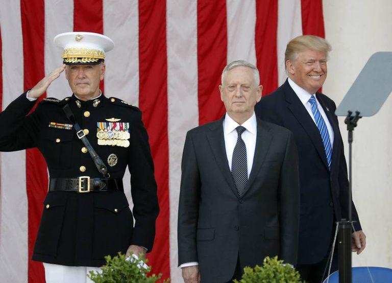 Trump and US defense secretary James Mattis at a ceremony commemorating war dead at Arlington.