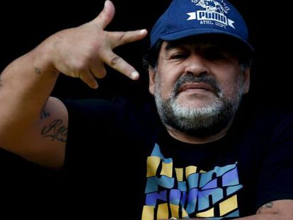 Maradona signals to photographers at the stadium during 'La Bombonera' match in Argentina.