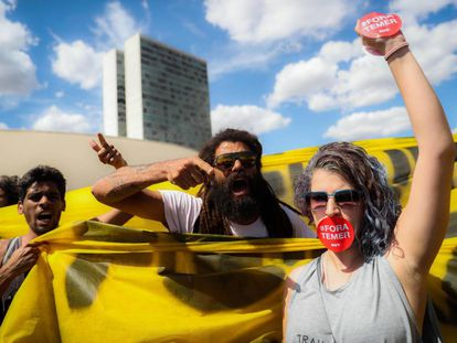 Supporters of Dilma Rousseff stage a protest.
