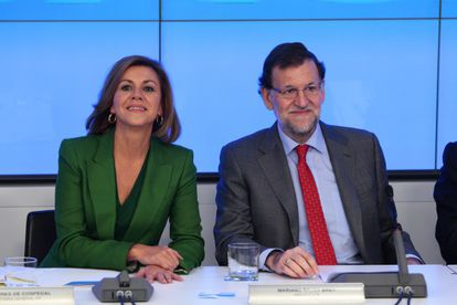 PP secretary general Maria Dolores de Cospedal and Prime Minister Mariano Rajoy.