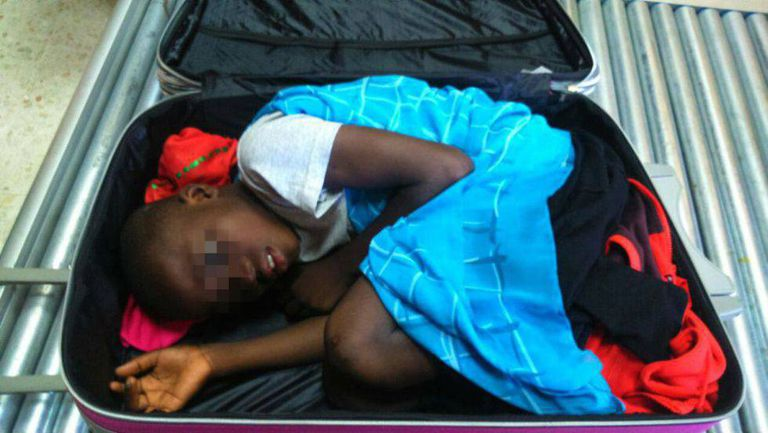 The eight-year-old boy who got across the border in a suitcase.