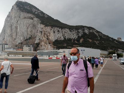 People crossing the runway at Gibraltar airport.
