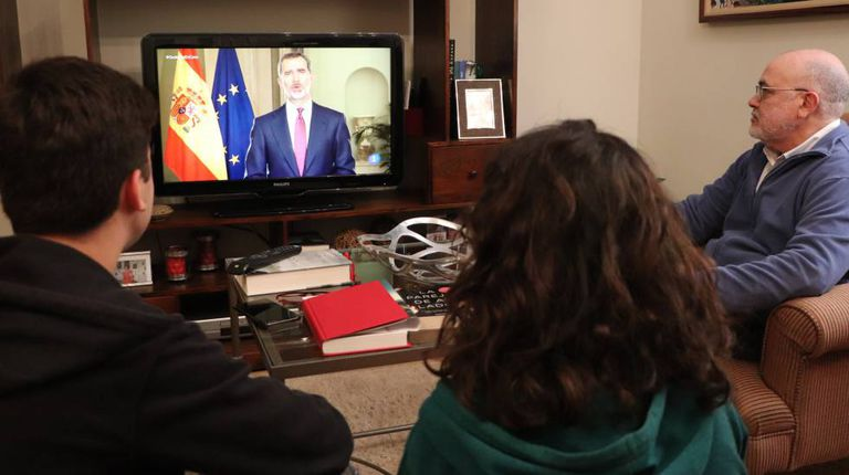 A family from Seville watching Felipe VI's speech on Wednesday.