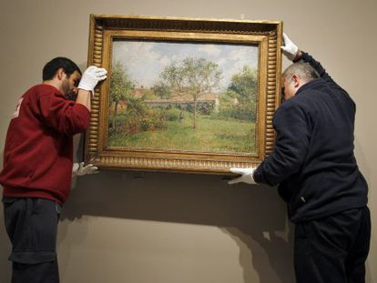 Setting up the Pissarro exhibition, one of the Thyssen's major shows in 2013.