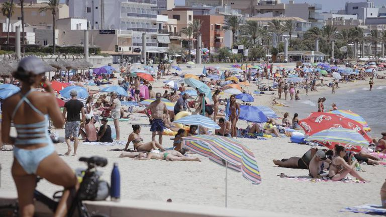 Tourists in Mallorca, where hundreds of British holidaymakers made bogus food poisoning claims.