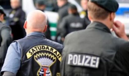 A still from a YouTube video showing members of Satudarah MC being watched by German police.