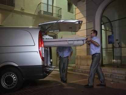 Funeral service workers leave the Dalí Theatre-Museum in Figueres, Spain.