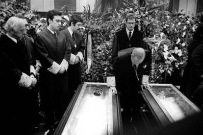 Antonio Pedrol Rius, President of the Professional College of Lawyers of Madrid leans over the coffins of the lawyers killed in the 1977 massacre.