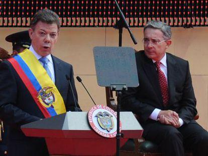 Uribe, right, at Santos' inauguration in 2010.