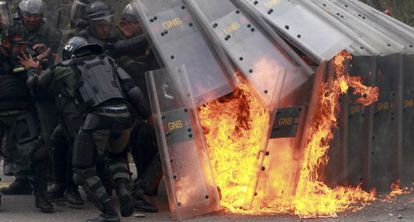 National guards react to a Molotov cocktail thrown by students during a protest