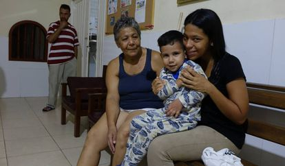 Venezuelan Susana Guevara, with one of her children, in Colombia.