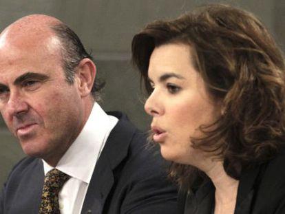 Deputy Prime Minister Soraya Sáenz de Santamaría and Economy Minister Luis de Guindos on Friday morning.