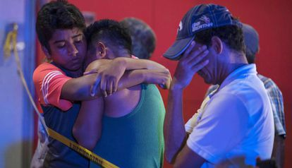 Tears and hugs after a shooting that left 23 people dead in a bar in Veracruz, Mexico last August.