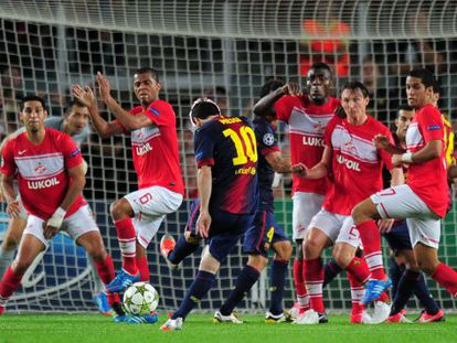 Saving the day: Barcelona's Lionel Messi (center) in Champions League action against Spartak Moscow.