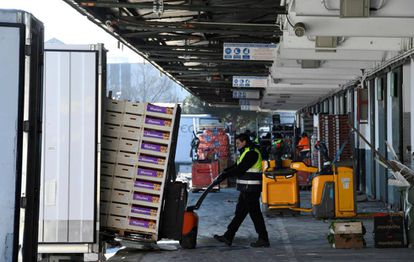 Trucks filled with fresh produce inside Mercamadrid, one of the world's largest wholesale markets, on Tuesday.