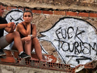 Anti-tourism graffiti in Barcelona's El Carmel neighborhood.