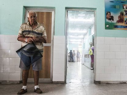 A patient waits with his X-Ray to see a doctor in the 18 October hospital in Havana.