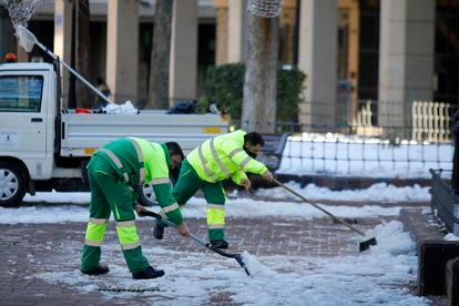 Municipal workers clearing the streets in Albacete, in the region of Castilla-La Mancha, which has been hard hit by the snow and cold.