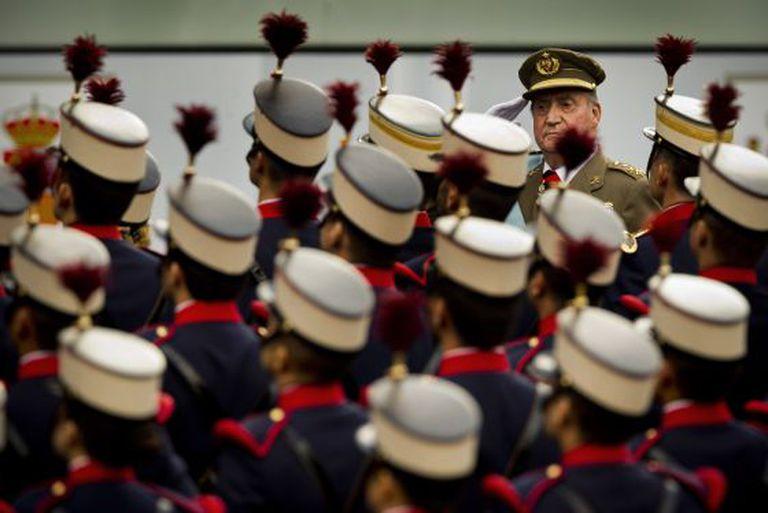King Juan Carlos reviews troops at Friday's military parade in Madrid,