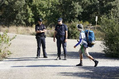 Police officers stationed along the Camino de Santiago.