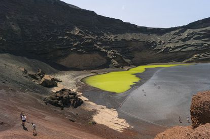In the east of Lanzarote, this volcano crater emerges at sea level. Beside it sits a peculiar green lake, whose color is caused by the algae and other organisms that live within it. The surrounding black sand provides for an especially striking contrast.