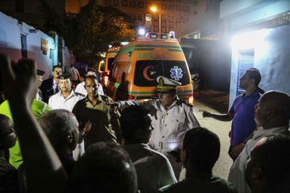 An ambulance takes victims of the bombing attack to Cairo.