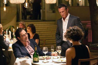 Sean Penn (right) with Javier Bardem in 'The Gunman.'