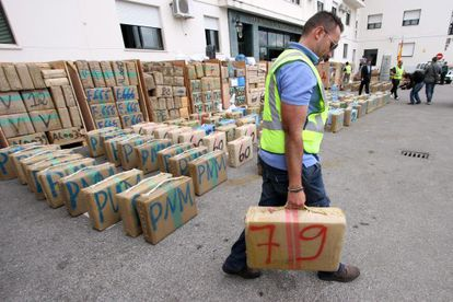An officer from the Civil Guard moves a packet of hashish from the 32.3-ton haul of the drug that was intercepted in a truck at the port of Algeciras, Cádiz province.