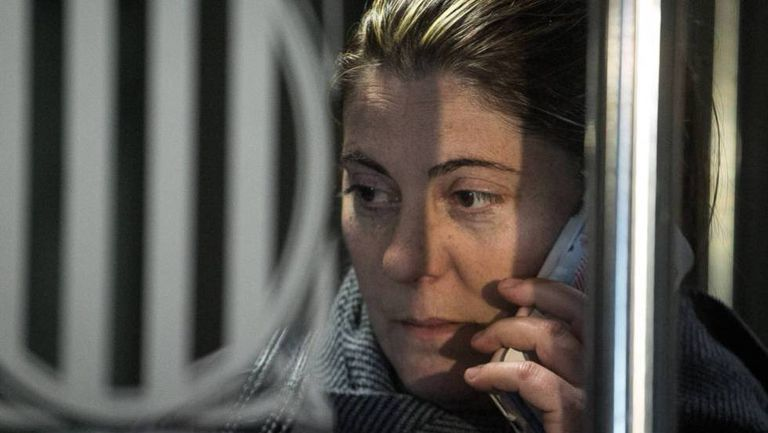 Nadia's mother speaks on the phone at the courthouse in La Seu d'Urgell.