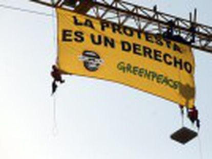 Environmental group unfurls banner against controversial law. The organization says the legislation penalizes peaceful demonstrations