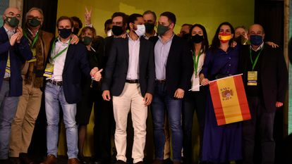 Vox  leader Santiago Abascal (front row, third from right) with regional candidate Ignacio Garriga after learning that the far-right group has entered the regional parliament with 11 seats.
