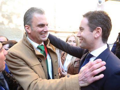 Vox's J. Ortega Smith (r) greets T. García Egea of the PP.