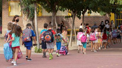 Children returning to school after the summer break in Murcia last week.