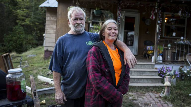 Randy and Alma McNeely outside their house in McDowell County.