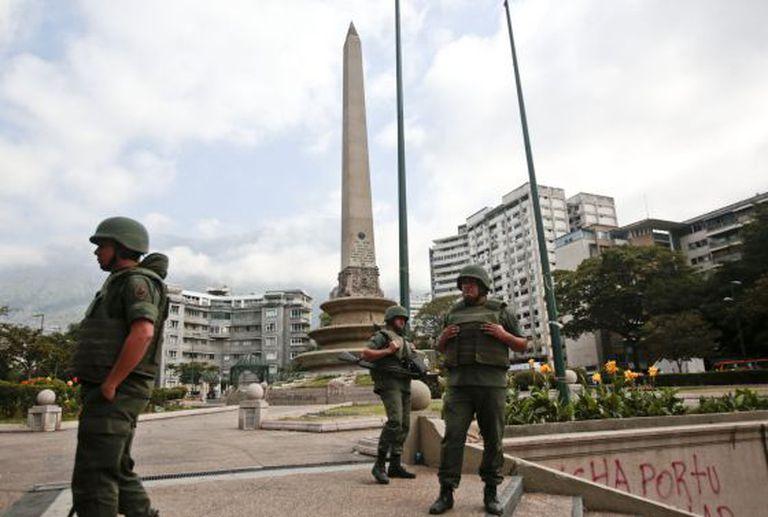 Members of the Venezuelan National Guard watch over Caracas's Plaza Altamira.